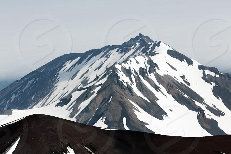Volcano landscape of Kamchatka Peninsula: view to top of Kozelsky Volcano from crater of Avacha Volcano. Avachinsky-Koryaksky Group of Volcanoes Kamchatka Region Russian Far East Eurasia. photo