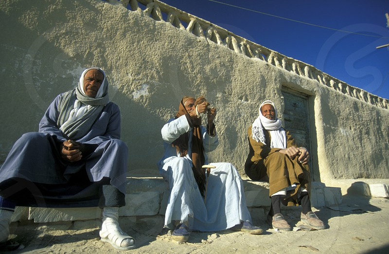 people in the town and Oasis of Farafra in the lybian or western desert of Egypt in north africa photo