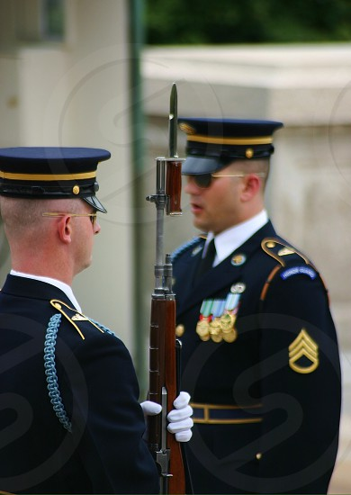 Final inspection before guarding the tomb of the unknown soldier.  All soldiers are responsible for their perfect appearance - uniform firearm right down to the smallest detail. photo