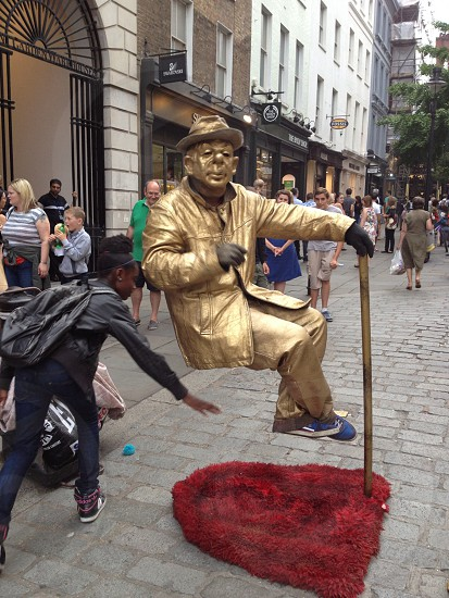 Trick of the eye tourist attraction London sculpture gold magic photo