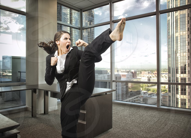 A young female executive shows her willingness to be aggressive in the current business climate. photo