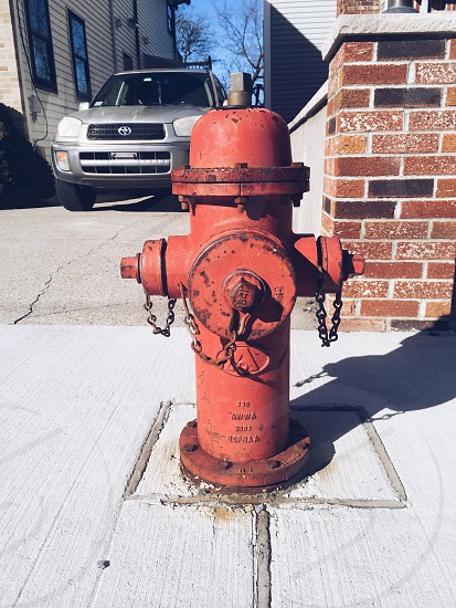 orange metal fire hydrant photo