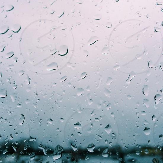 water droplets on glass window photo