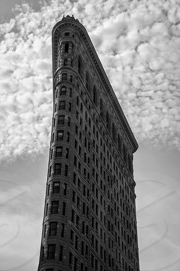 Looking up at the iconic Flatiron building in New York City photo