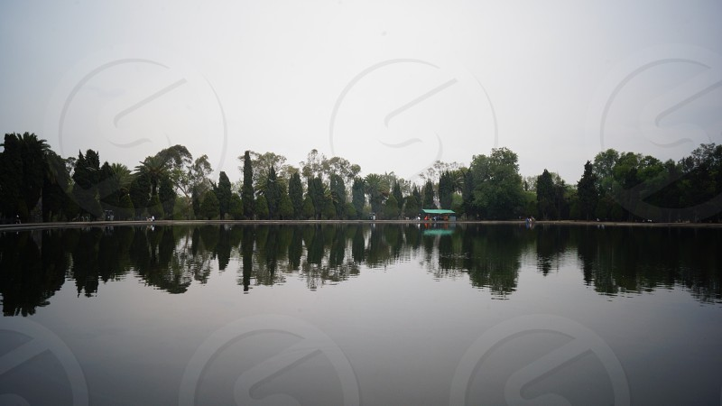 Peaceful scenery of the lake in 2nd section of Bosque de Chapultepec in México City México. photo