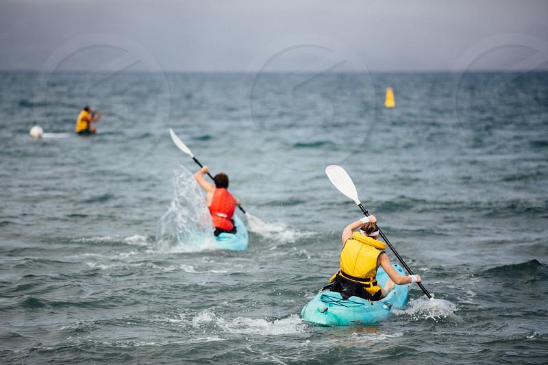 ocean sea kayak boat sport recreation transportation transport competition activity summer family  photo