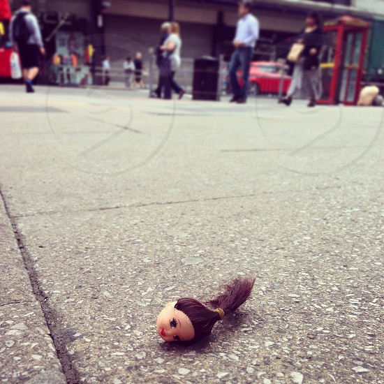 Dolls head on street photo