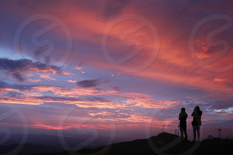 silhouette of people on mountain photo