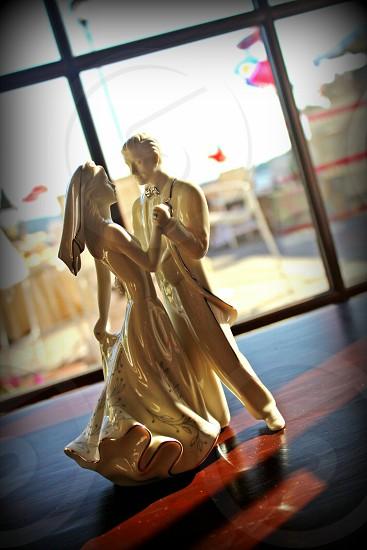 newly wed couple dancing ceramic figurine photo