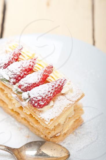 fresh baked napoleon strawberry and cream cake dessert  photo