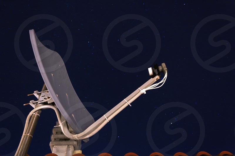 satellite dish receiver with a night starred sky photo