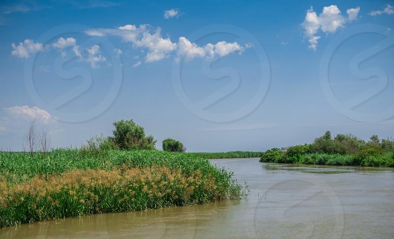 Danube River near the village of Vilkovo Ukraine on a sunny summer day photo