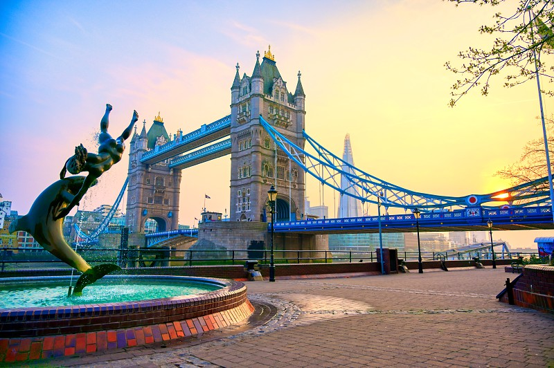 London United Kingdom - April 17 2019 : View of Tower Bridge on the River Thames with the Girl with Dolphin fountain created by David Wynne in 1973. photo