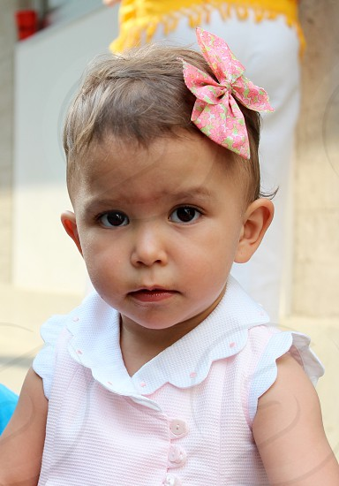 Little girl looking at the camera with a worried expression on her face. photo