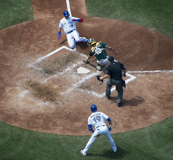 Troy Tulowitzki getting thrown out at home plate during a Toronto Blue Jays baseball game versus the Oakland Athletics at the Rogers Centre in Toronto. photo