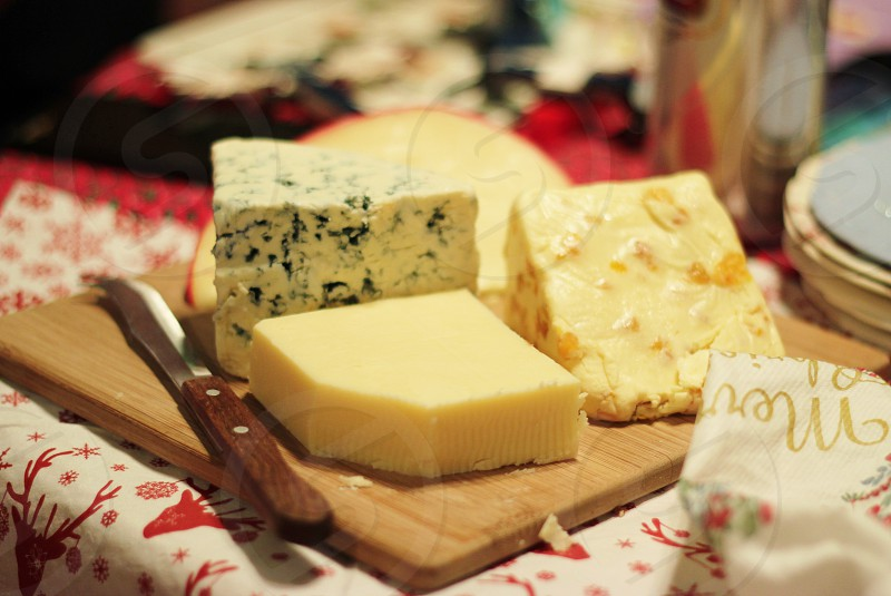 yellow cheese and white cheese on wooden chopping board photo