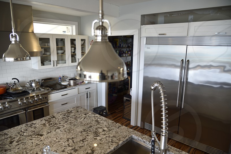 Modern Kitchen stainless gas pantry sink granite counters. photo