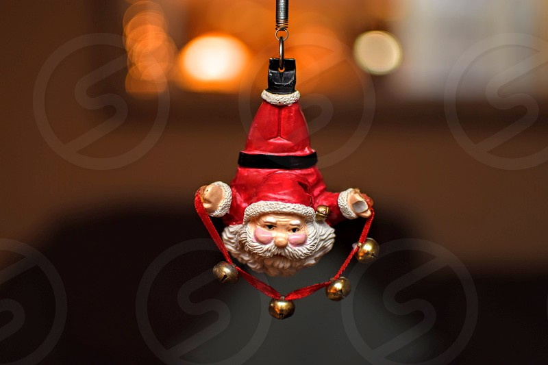 red and white santa clause hanging decor photo