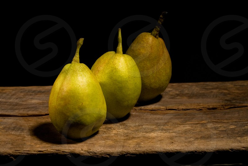 autumn fresh pears over old wood board  photo
