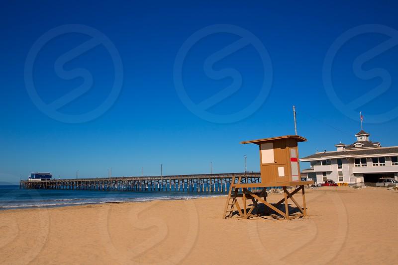 Newport pier beach with lifeguard tower in California USA photo