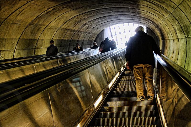 View going up an escalator tunnel in a Washington D.C. subway photo