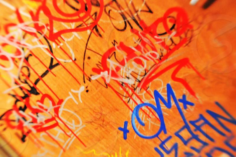 Graffiti on an orange wall  photo