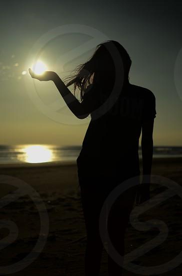Girl holding the sun.  photo