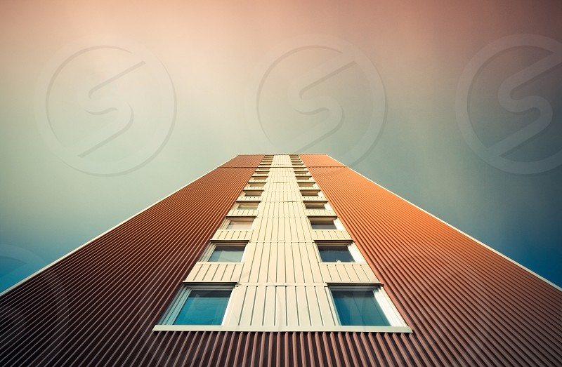 brown and white blue glass cover high rise building photo
