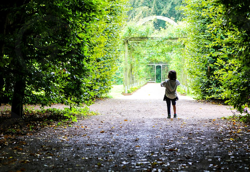 Facing extinction  small girl greens nature lush fresh air outdoors alone child unrecognizable person park growth photo