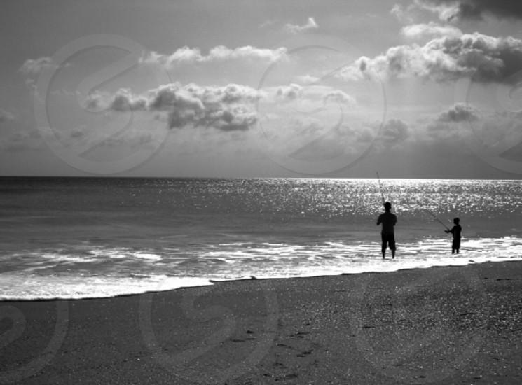 Fishing father son fish ocean bond bonding monochrome minimal peace man manhood childhood memories  photo
