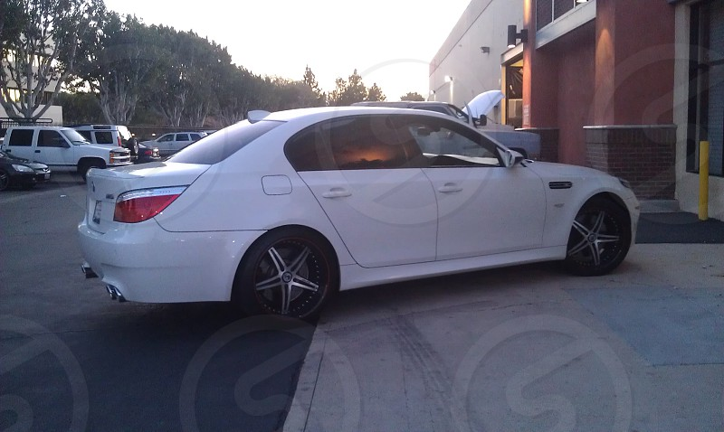 California sunset over old 2008 BMW M5 in Riverside CA photo