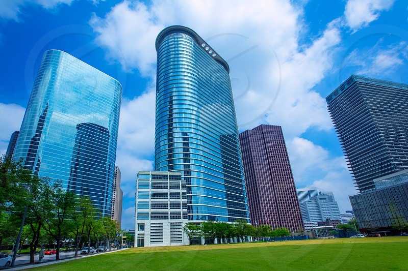 Houston downtown skyscrapers disctict with mirror blue sky reflection photo