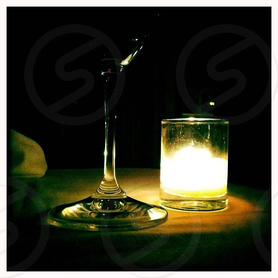 crystal clear wine glass with yellow votive candle photo
