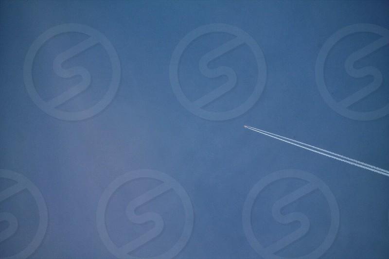 Negative spaceblueskyplaneaeroplanestream photo