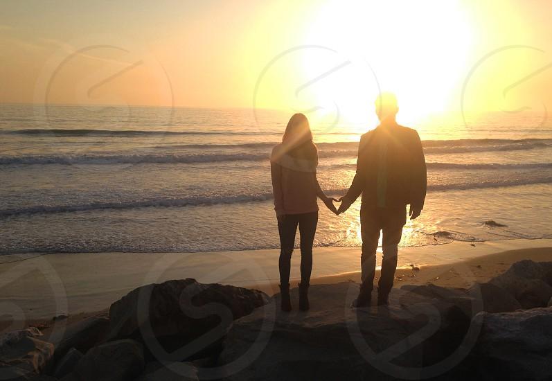 couple sunset inspiring heart ocean beach photo