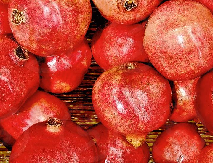 A pile of pomegranates photo