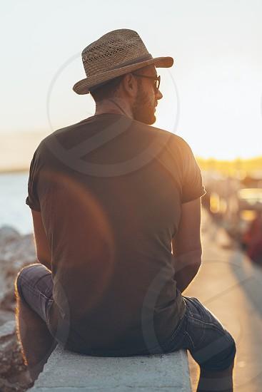 Man enjoying the sunset in the harbor photo