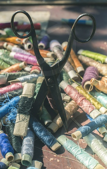 Vintage sewing thread and scissors photo