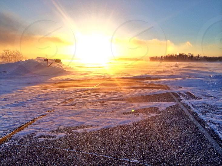 Sunset snow landscape color Minnesota sun drifting  photo