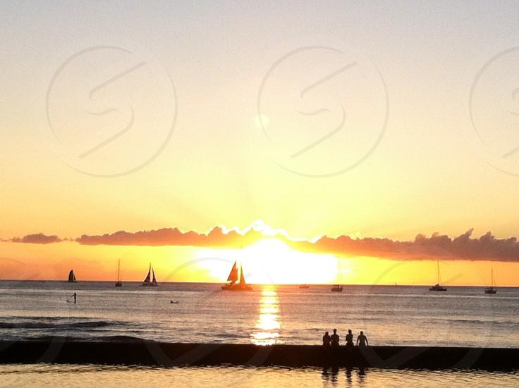 Sunset & sailboats in Oahu HI  photo