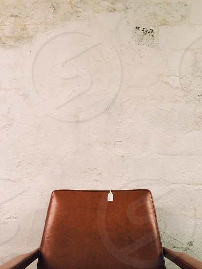 Negative space empty chair price tag minimalism mid century modern stucco wall chair seat  photo
