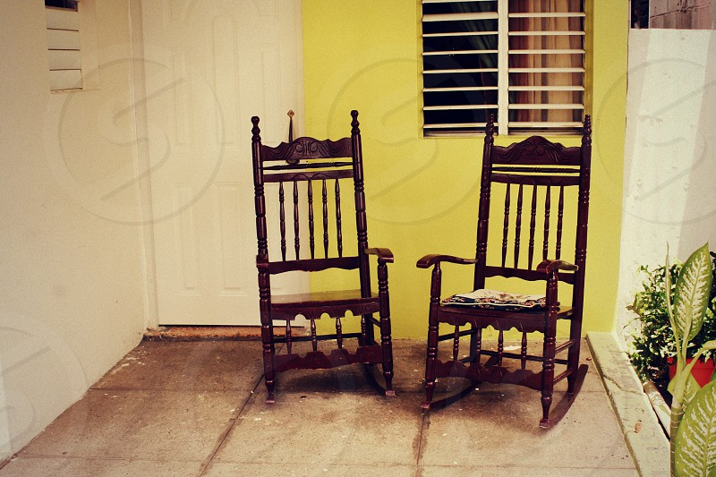 """Left"" Two chairs sit lonely waiting for their owners to return. photo"