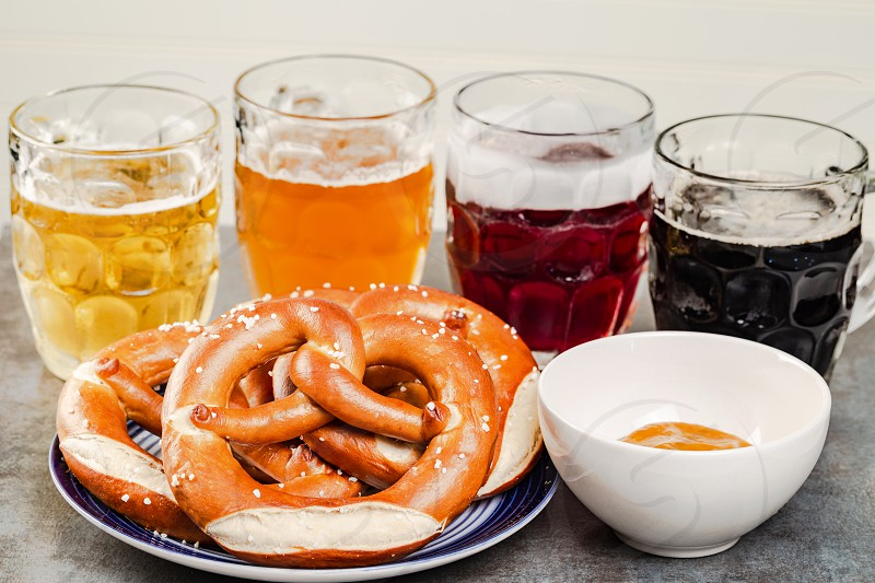 Craft beers with pretzels and mustard photo