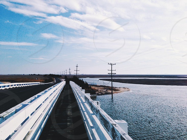 gray bridge near electric post photo
