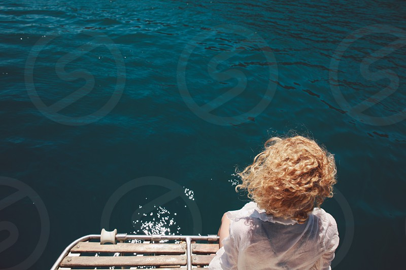 vacation blue water girl curly hair blonde hair photo