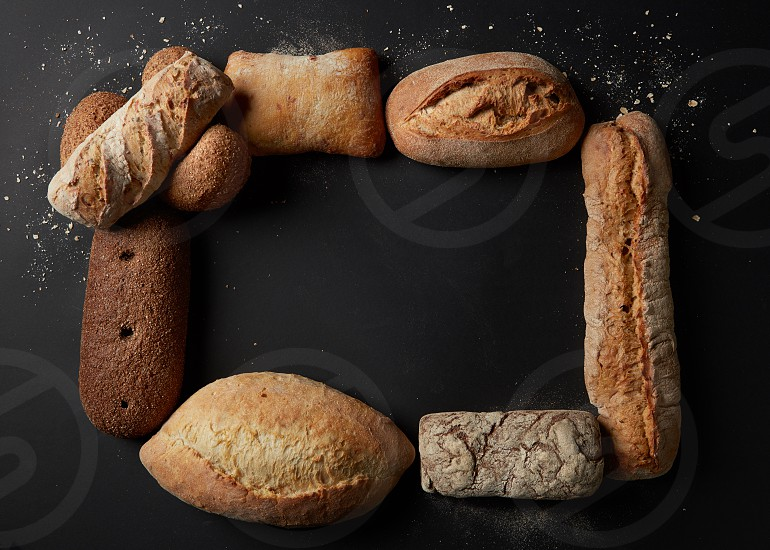 Baking and cooking concept background. Top view of different kinds of bread represented in form of frame. Copy space in middle may be used for your ideas emotions. photo