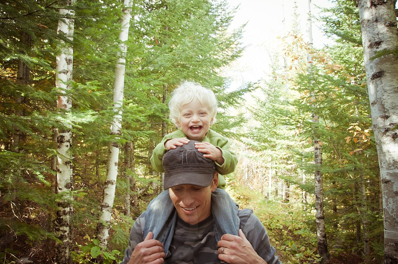 active family father son boy male woods trees forest happy smile shoulders ride riding laugh blonde dad trail hike hiking exercise outdoors summer photo