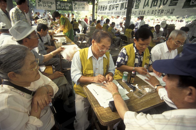 seniors at a medical examination place at the Tapkol Prk in the city of Seoul in South Korea in EastAasia.  Southkorea Seoul May 2006 photo