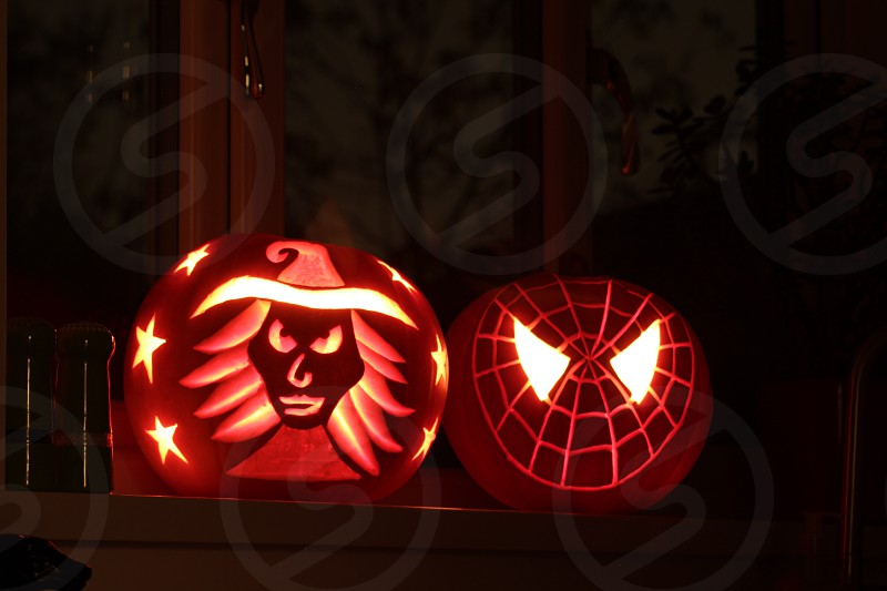 witch and spider-man pumpkin carvings photo