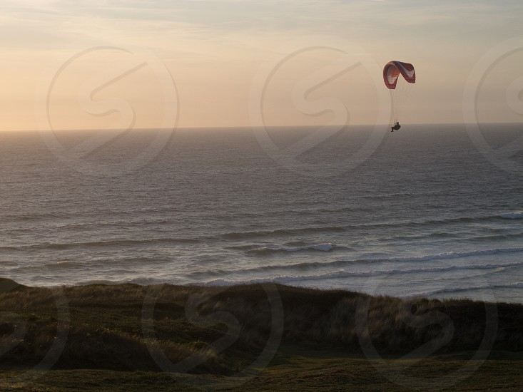 ParaglidingLanscapeflyingseadevonuk photo